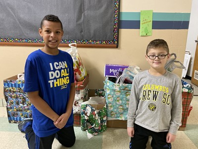 Photo Four: Two Caring Club Members, (L) Maddox Purins and Andrew Brine with the Caring Club Donations for preschools in Poland.
