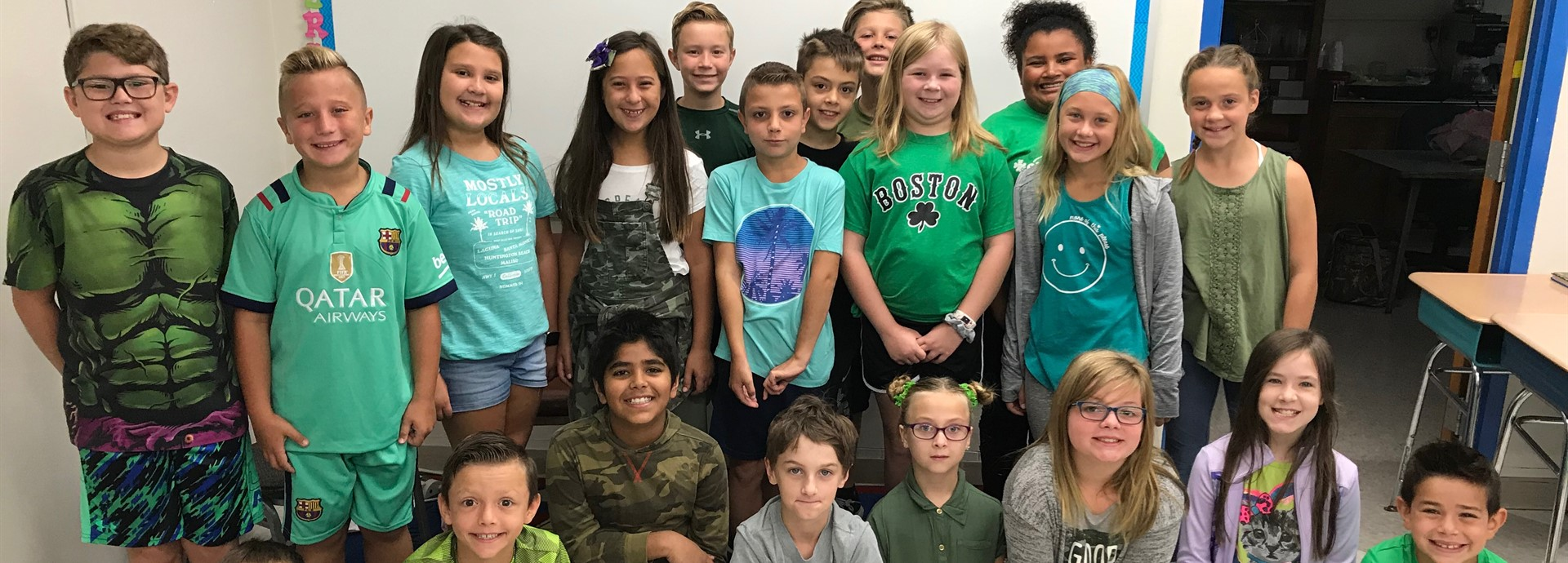 students wearing green for Start With Hello Week.