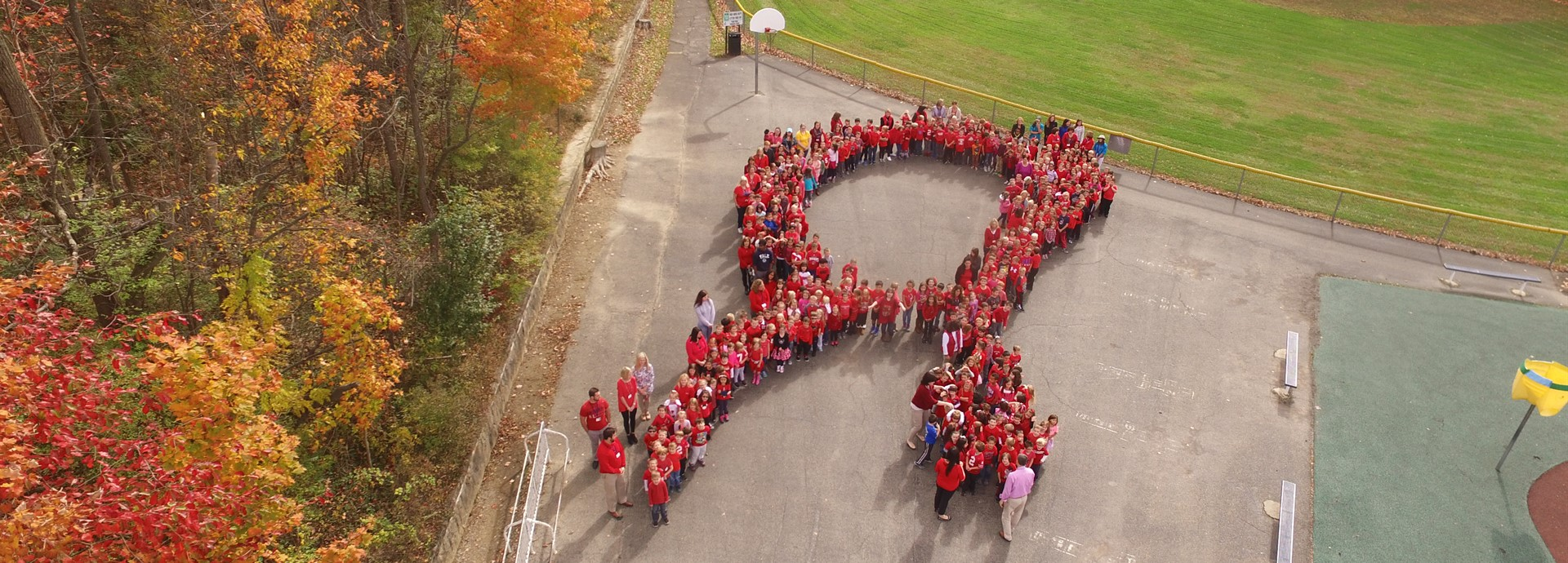 red ribbon week with staff and students shaped as ribbon