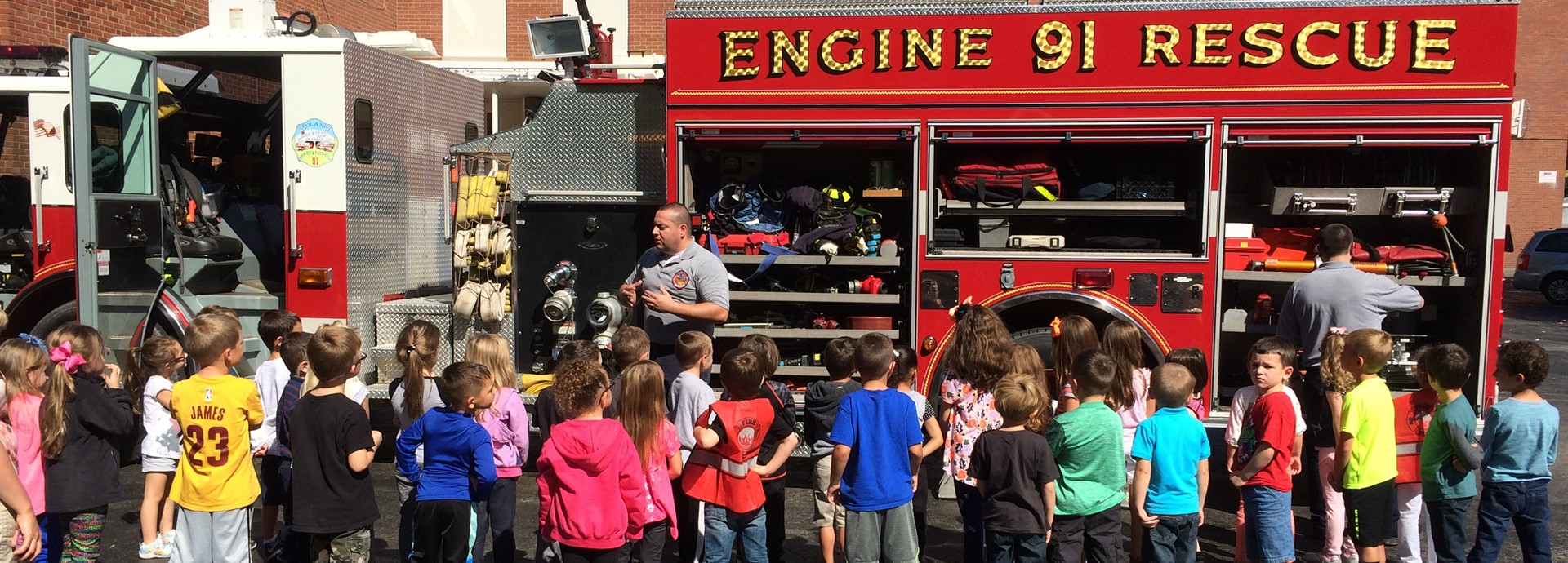 students watching fire truck presentation